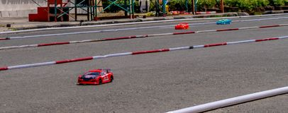 Remote control car race competition on tarmac circuit. Hobby and leisure activity royalty free stock images
