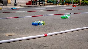 Remote control car race competition on tarmac circuit. Hobby and leisure activity royalty free stock photography