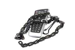 Remote control and chain Stock Photo