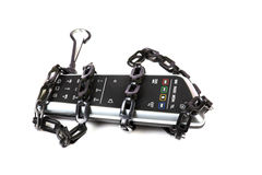 Remote control and chain Royalty Free Stock Image