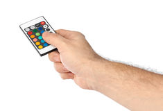 Remote control for change colors in hand Royalty Free Stock Image