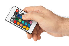 Remote control for change colors in hand Stock Image