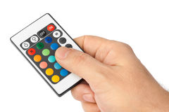 Remote control for change colors in hand Stock Images