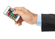 Remote control for change colors in hand Royalty Free Stock Photography
