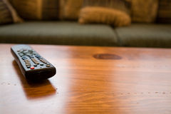 Remote Control and coffee table Stock Image