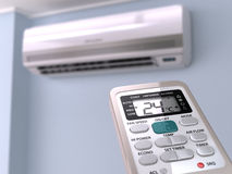 Remote control directed on air conditioner systrem. Stock Photography