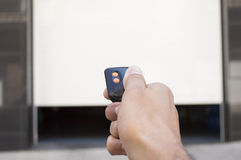 Remote control with the door open Stock Photos