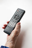 Remote Control Elderly. An elderly hand with a TV DVD remote control royalty free stock photos