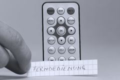 Remote control in English and Fernbedienung the German word. White background royalty free stock photo