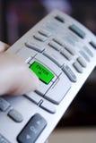 Remote control enter button. Closeup of a remote control green enter button Royalty Free Stock Photos