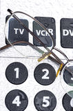 Remote control and glasses Royalty Free Stock Photography