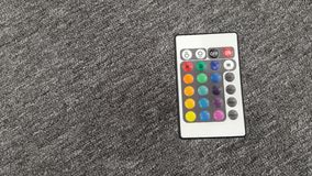 Remote control  on grey background Royalty Free Stock Photography
