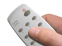 Remote control in hand. Remote control with buttons 1-9 and Power in hand - isolated Stock Photo