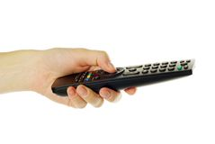 Remote control in hand Royalty Free Stock Photos