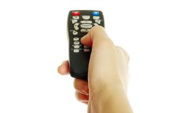 Remote control in hand stock photography