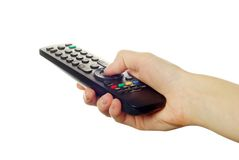 Remote control in hand Stock Images