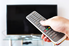 Remote control in the hand Royalty Free Stock Photography