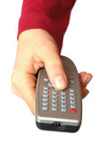 Remote control in hand Stock Photo
