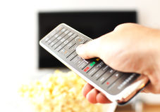 Remote control in the hand Stock Images