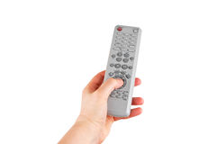 Remote control in hand. Remote control for DVD player in hand on white royalty free stock images