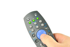 Remote control in the hand Royalty Free Stock Photos