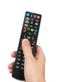 Remote control in hand Stock Photo