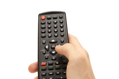 Remote control in hand. Man holding TV remote controle isolated on white Royalty Free Stock Image