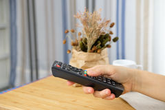 Remote control in hand, Stock Photos