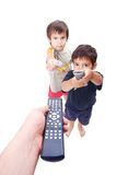 Remote control in hands. Three remote controlers used by father and two boys Royalty Free Stock Photography