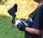 Remote control a helicopter crone. Royalty Free Stock Photo
