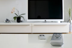 Remote control for home cinema. Two remotes on white table for home cinema and entertainment royalty free stock image
