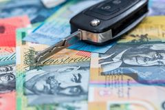 Remote control key from car on australian dollars.  stock image