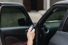 Remote control  key Car in hand , system automatic Stock Photos