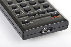 Remote control keypad black in closeup on white isolated Stock Images