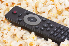 Remote control of player in popcorn Royalty Free Stock Photography