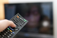 Remote control pointing towards the TV Royalty Free Stock Photo