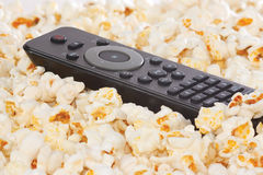 Remote control in popcorn closeup Stock Image