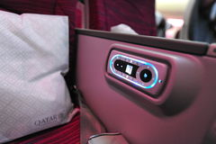 Remote control of the Qatar Airways Boeing 787-8 Dreamliner inflight entertainment system (IFE) at Singapore Airsho Stock Images