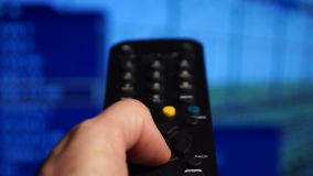 Remote control smart tv.Watching tv,changing channels, blurred TV. Remote control. Watching tv,changing channels, blurred TV stock footage