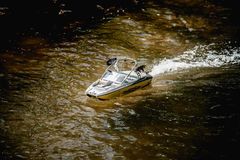 Remote Control Speedboat in Water Stock Images