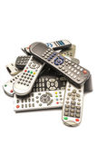 Remote control. Stack of remote wireless control electronics device on white background stock images