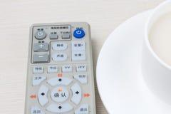 Remote control and tea Stock Photos
