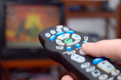 Remote control and TV Royalty Free Stock Photos