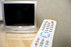 Remote control and tv Royalty Free Stock Images