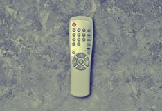 Remote control from TV on a concrete table. Top view.  royalty free stock images
