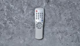 Remote control from TV on a concrete table. Top view.  Stock Photos