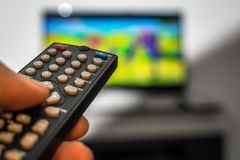 Remote Control TV. Watching tv and using remote control Stock Photo