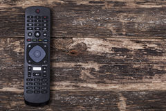 Remote control TV. On Wooden Background Royalty Free Stock Photos