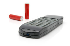 Remote control and two batteries stock images