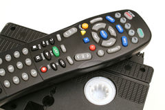 Remote control with vhs tapes upclose. A remote control with vhs tapes upclose stock images